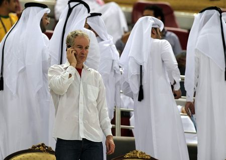 John McEnroe Phones in Doha
