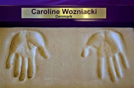 Caroline Wozniacki Doha.10 Cement Hands ap