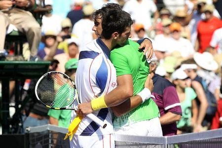 Novak Djokovic Rafael Nadal Miami.11 Hug at Net